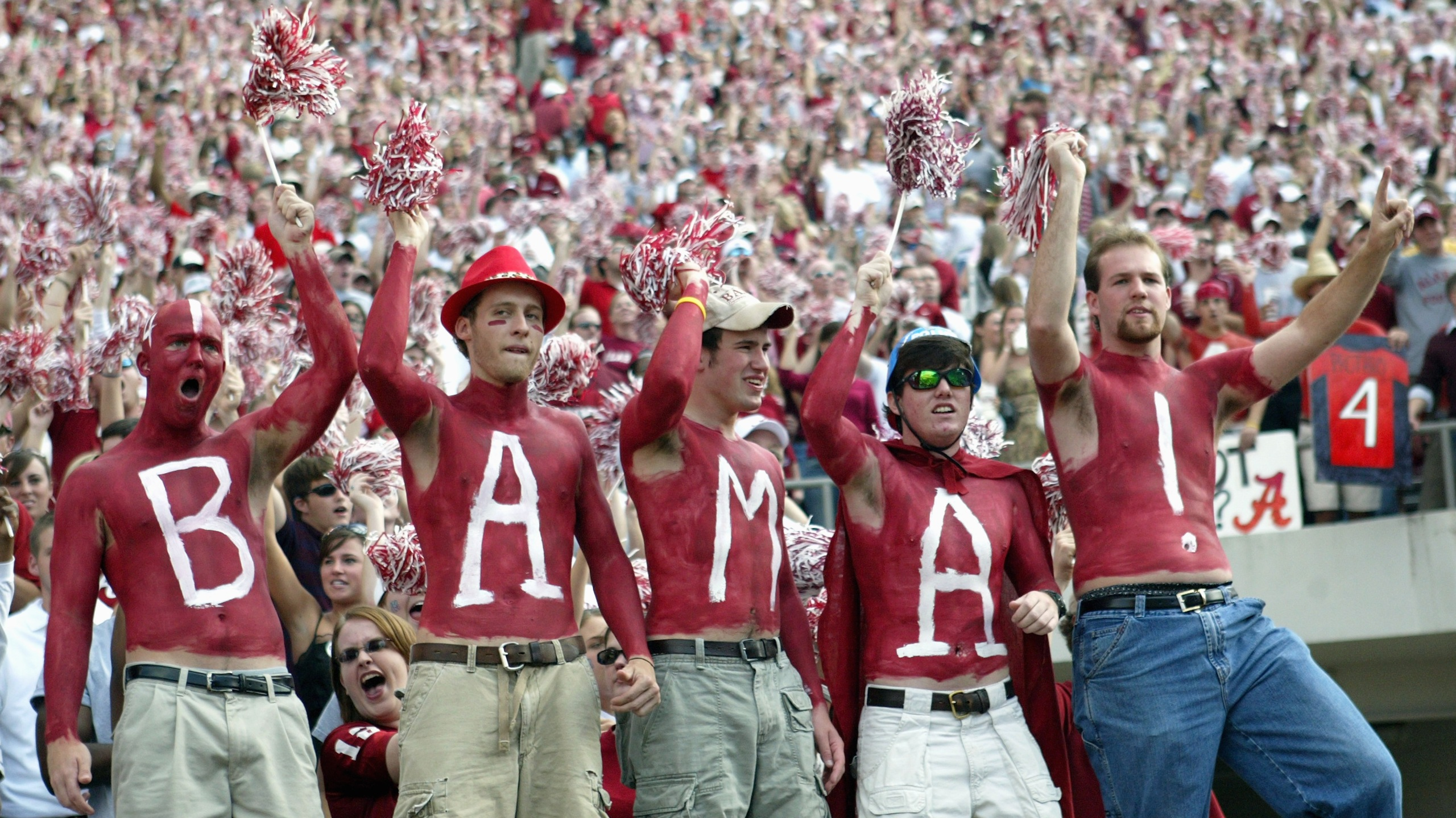 Fans of the University of Alabama Crimson Tide display their body paint during the game with the Louisiana State University Tigers on November 12, 2005 at at Bryant-Denny Stadium in Tuscaloosa, Alabama. (Credit: Chris Graythen/Getty Images)