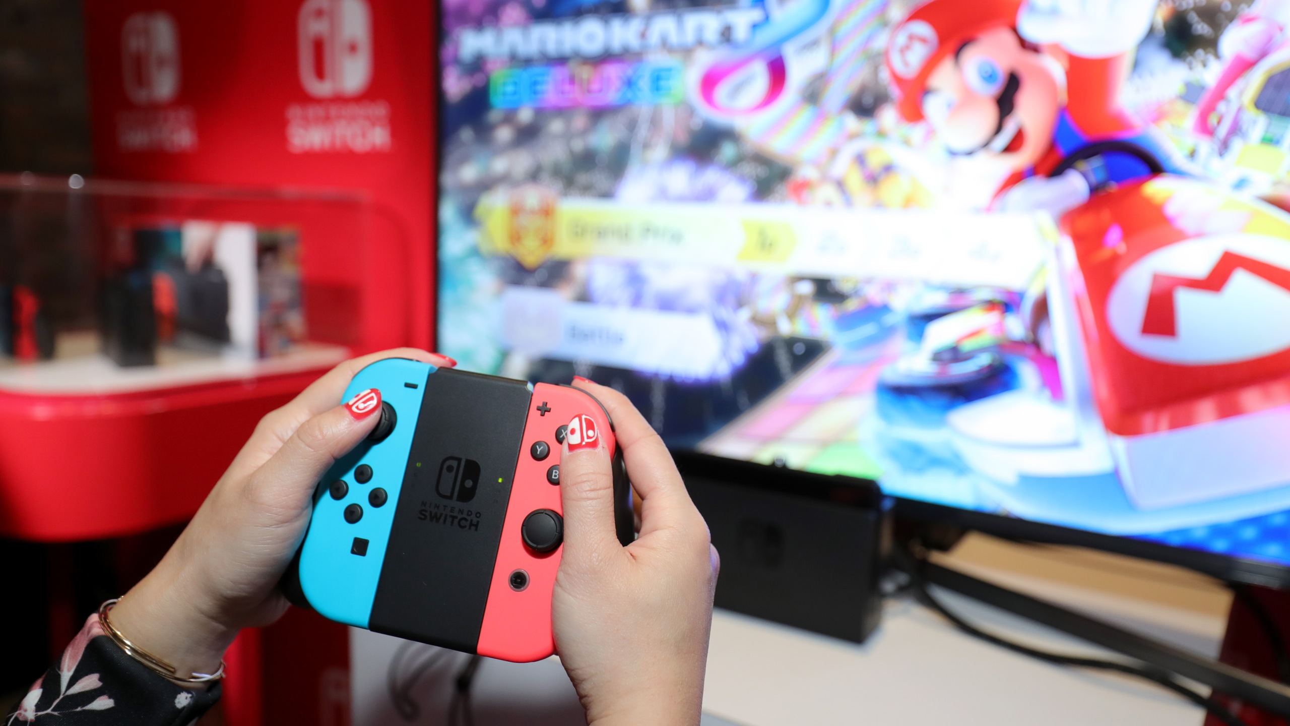 A guest enjoys playing Mario Kart 8 Deluxe on the new Nintendo Switch at a special preview event in New York on Jan. 13, 2017. Launching in March 3, 2017, Nintendo announced on Feb. 1, 2018, that Mario Kart will soon be available on mobile phones. (Credit: Neilson Barnard/Getty Images for Nintendo of America)