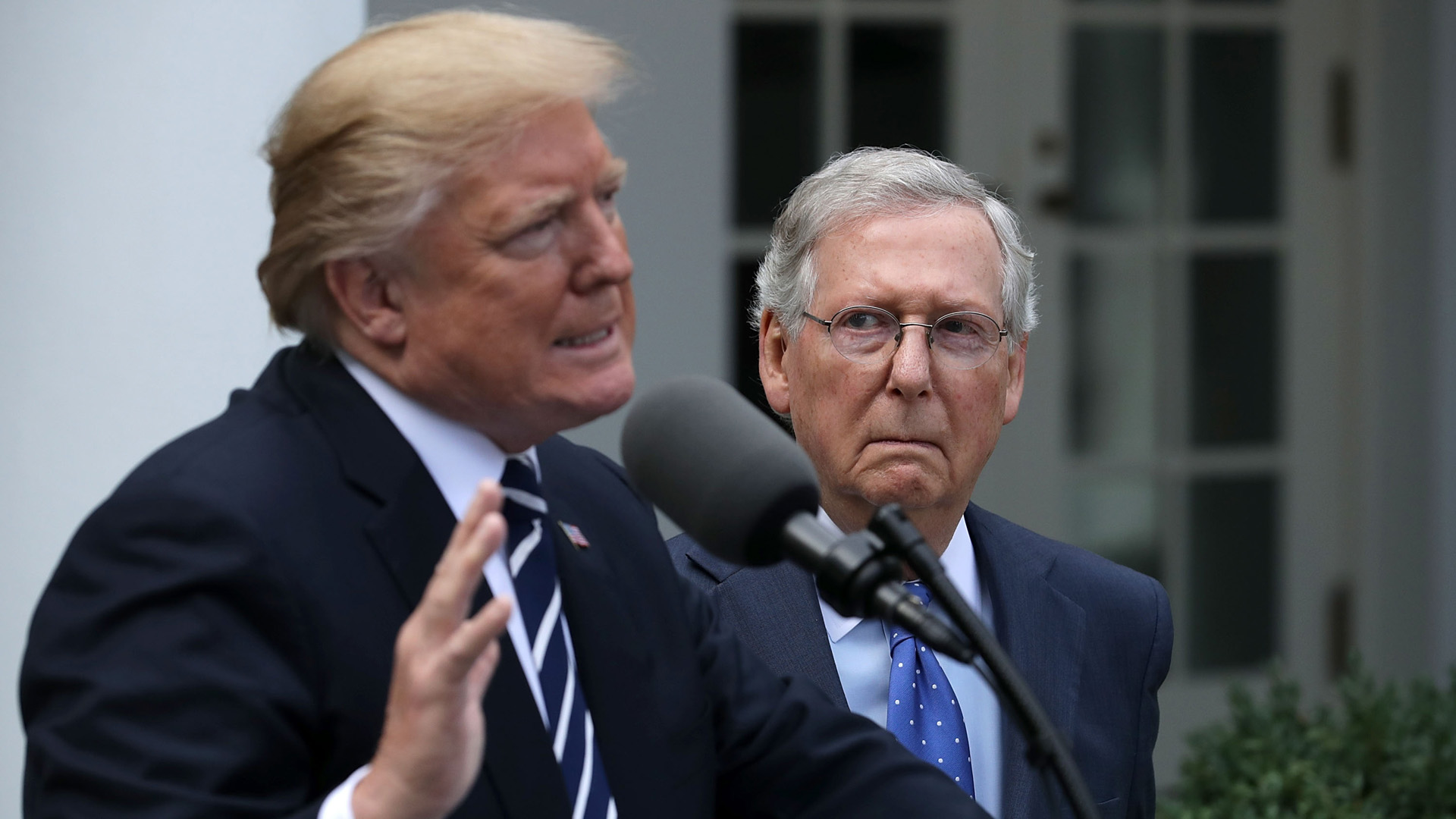 Donald Trump and Senate Majority Leader Mitch McConnell (R-KY) talk to reporters in the Rose Garden following a lunch meeting at the White House October 16, 2017 in Washington, DC. (Credit: Chip Somodevilla/Getty Images)