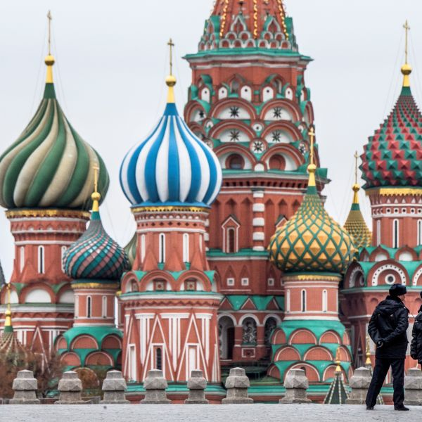 Two policemen stand guard on the Red Square in front of St. Basil Cathedral on National Unity Day in Moscow on November 4, 2017. (Credit: MLADEN ANTONOV/AFP/Getty Images)