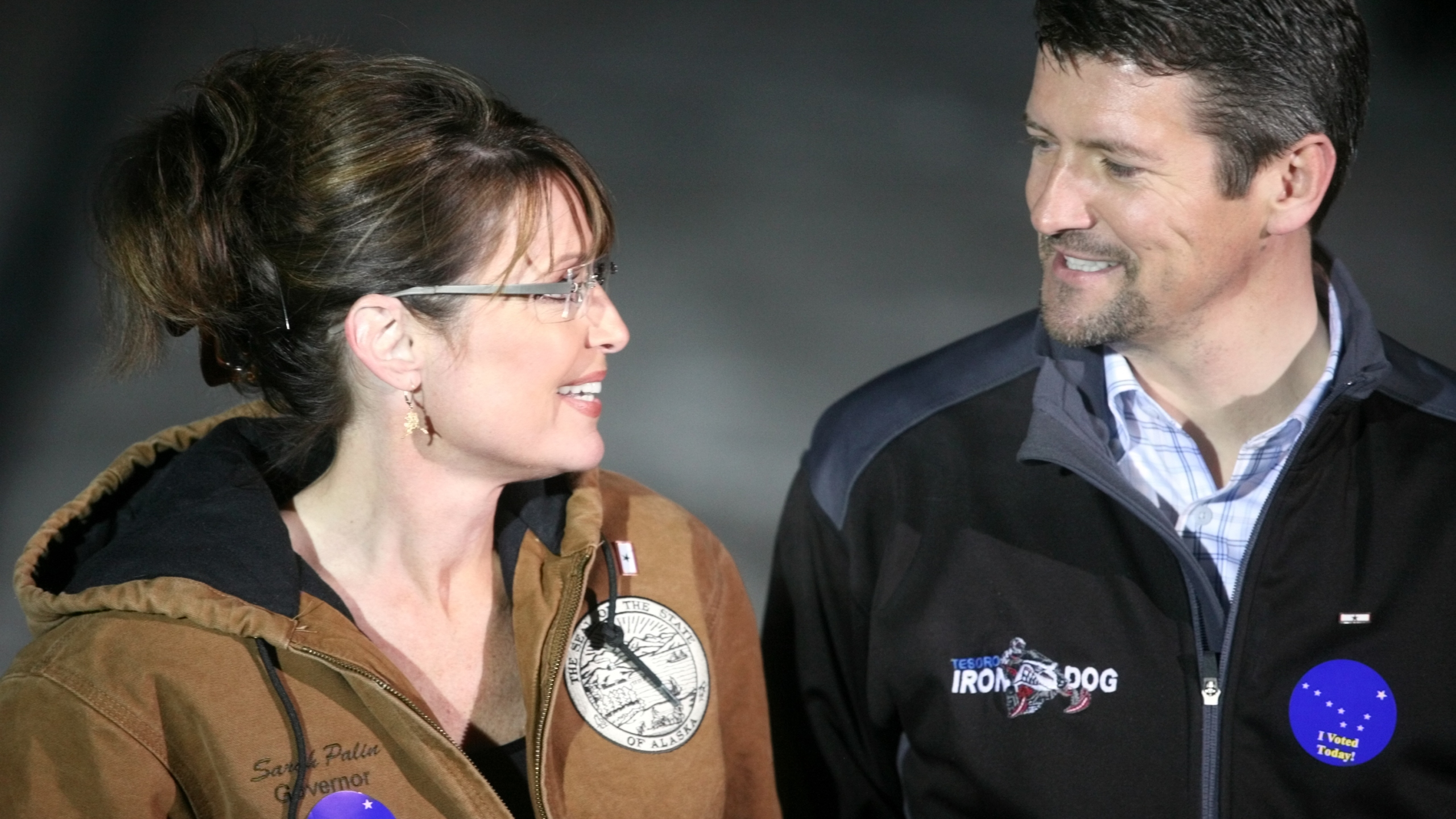 Republican vice-presidential nominee Alaska Gov. Sarah Palin and her husband Todd Palin exchange a glance while speaking with members of the media after casting their votes November 4, 2008 in Wasilla, Alaska. (Credit: Johnny Wagner/Getty Images)