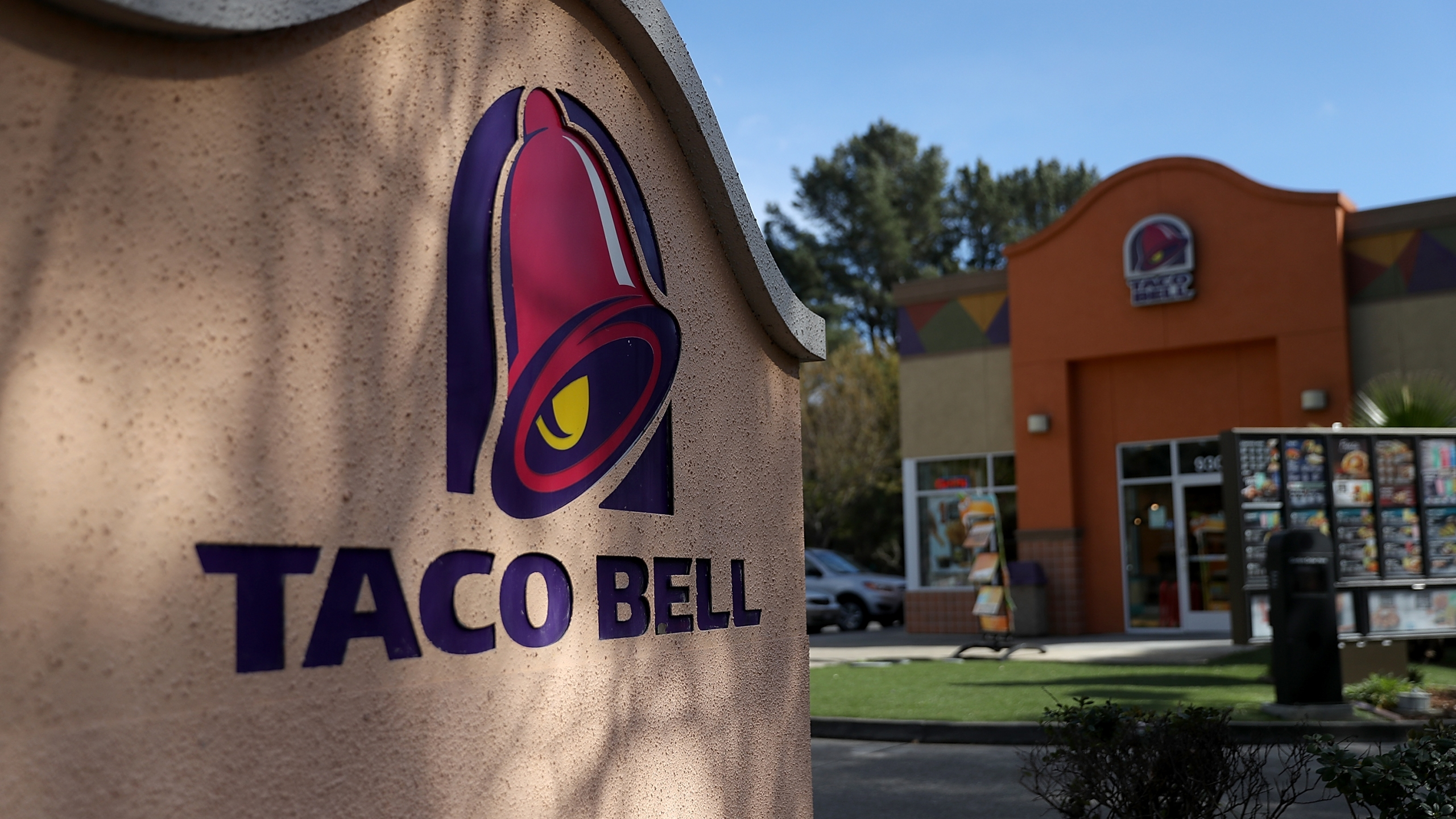 A sign is posted in front of a Taco Bell restaurant on February 22, 2018 in Novato, California. (Credit: Justin Sullivan/Getty Images)