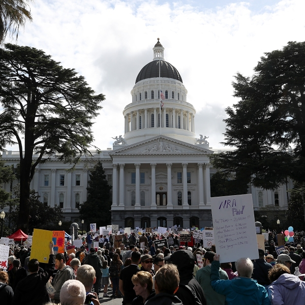 Protesters gather at the California State Capitol during a March for Our Lives demonstration on March 24, 2018, in Sacramento, California. (Credit: Justin Sullivan/Getty Images)