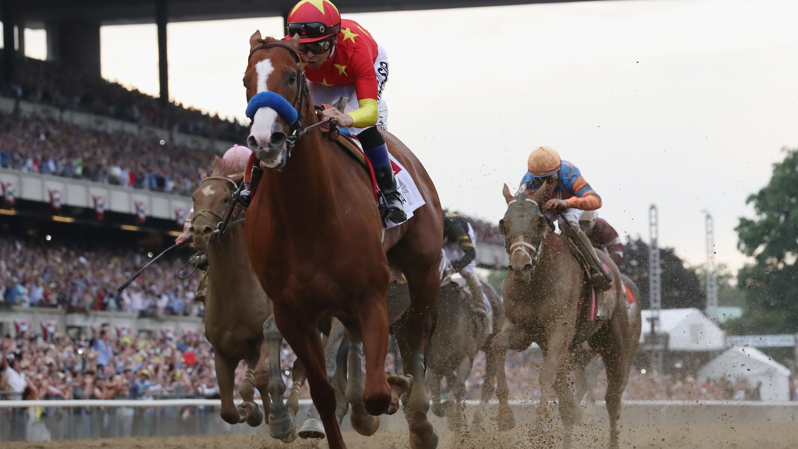 Justify #1, ridden by jockey Mike Smith crosses the finish line to win the 150th running of the Belmont Stakes at Belmont Park on June 9, 2018 in Elmont, New York. (Credit: Rob Carr/Getty Images)