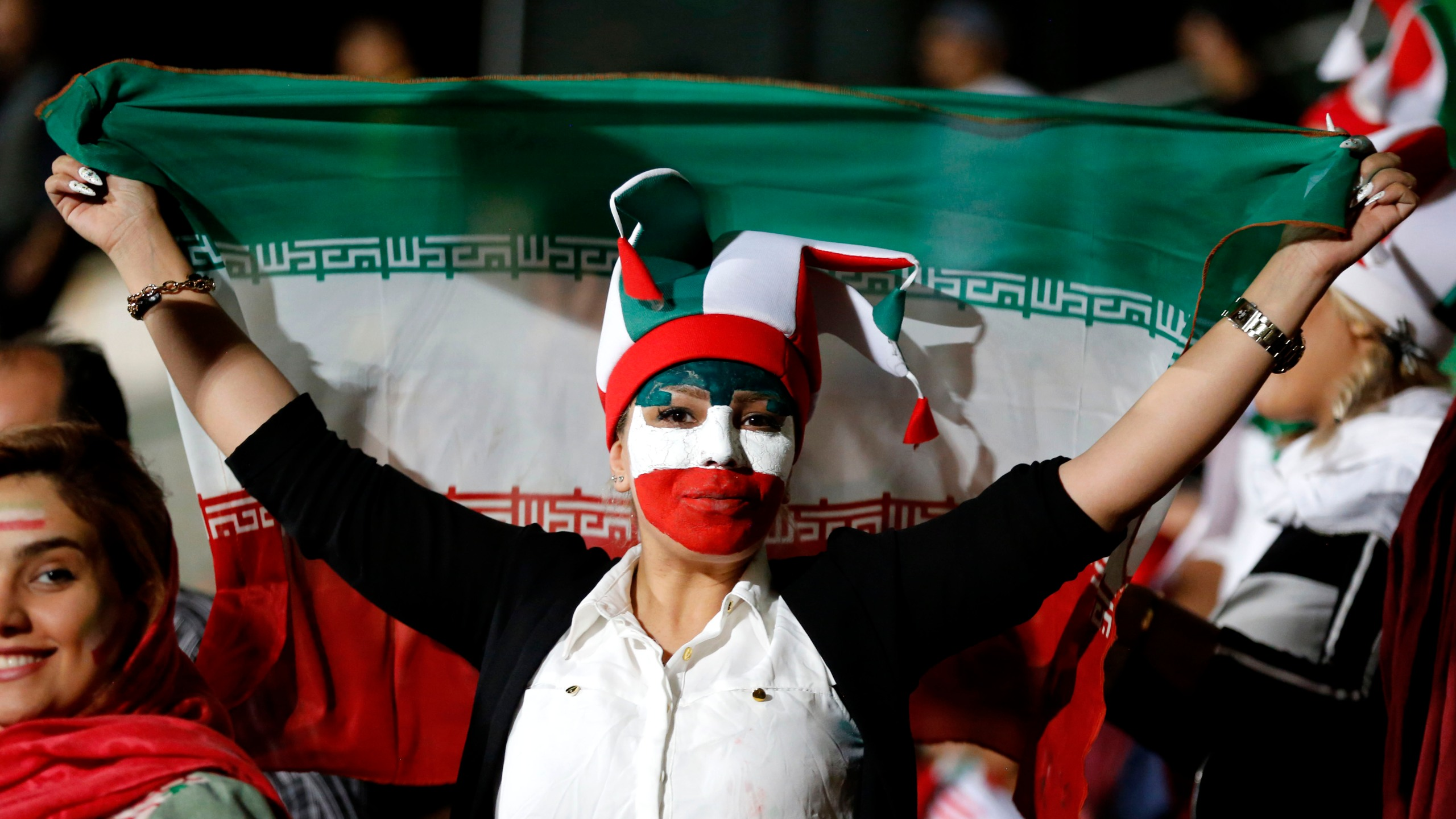An Iranian woman watches the World Cup soccer match between Portugal and Iran at Azadi stadium in Tehran on June 25, 2018.(Credit: Atta Kenare/AFP/Getty Images)