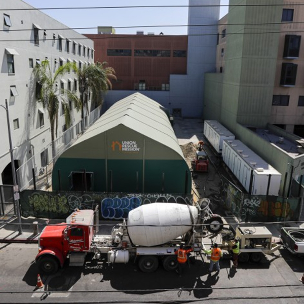 """A large """"membrane tent"""" at Union Rescue Mission will be used as a shelter for homeless people in Los Angeles. Trump administration officials toured a similar shelter this week as part of their fact finding mission on California's homelessness crisis.(Credit: Irfan Khan/Los Angeles Times)"""