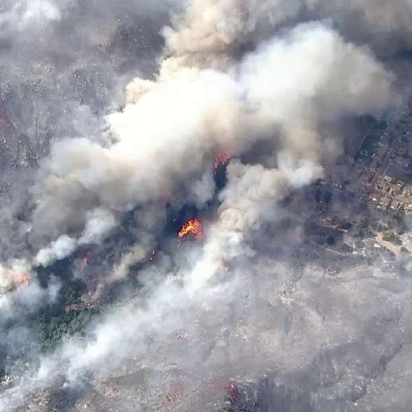 The Tenaja Fire burns dangerously close to homes in the Murrieta area on Sept. 5, 2019. (Credit: KTLA)