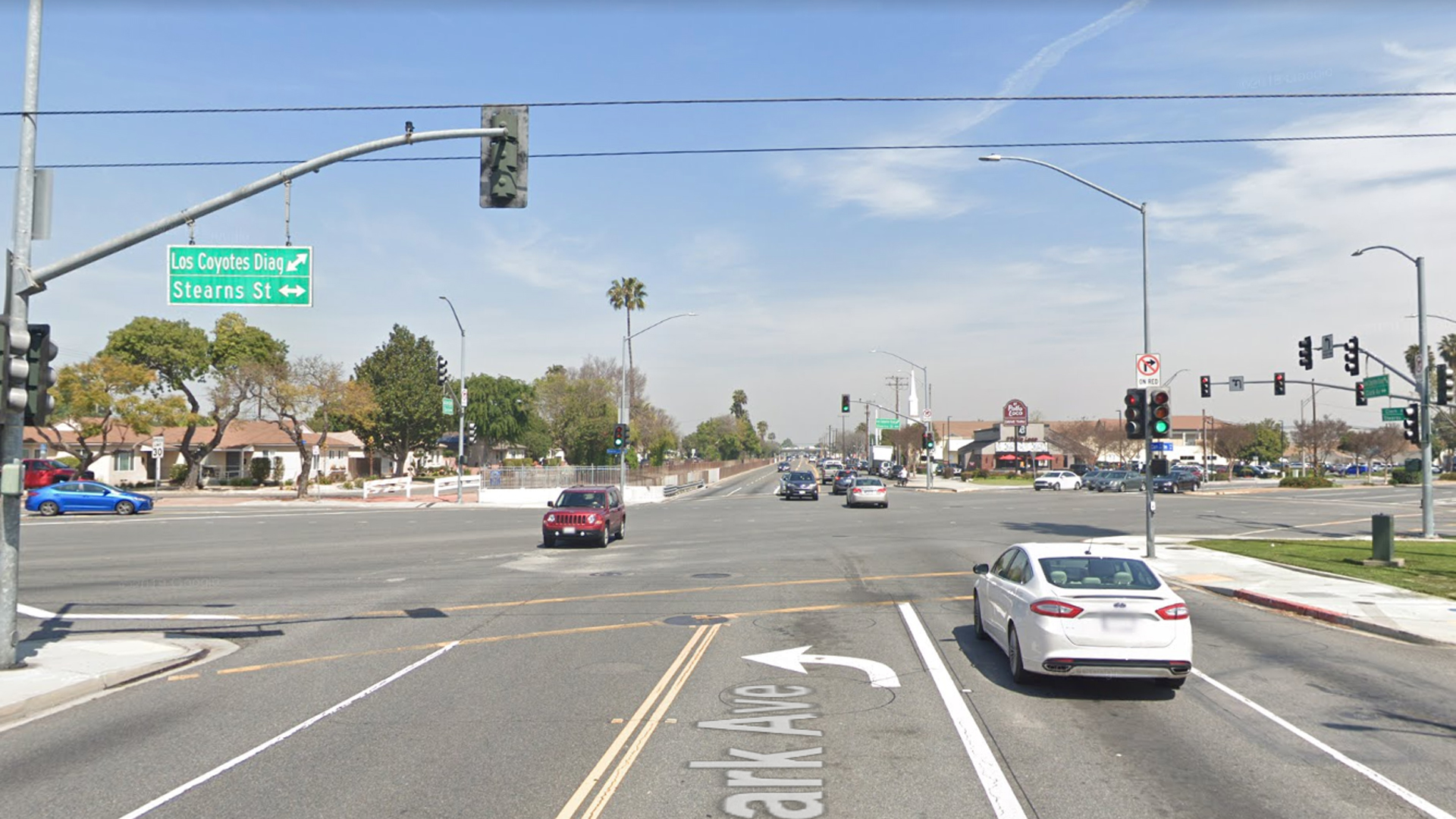 The intersection of Los Coyotes Diagonal and Stearns Street in Long Beach, as viewed in a Google Street View image.
