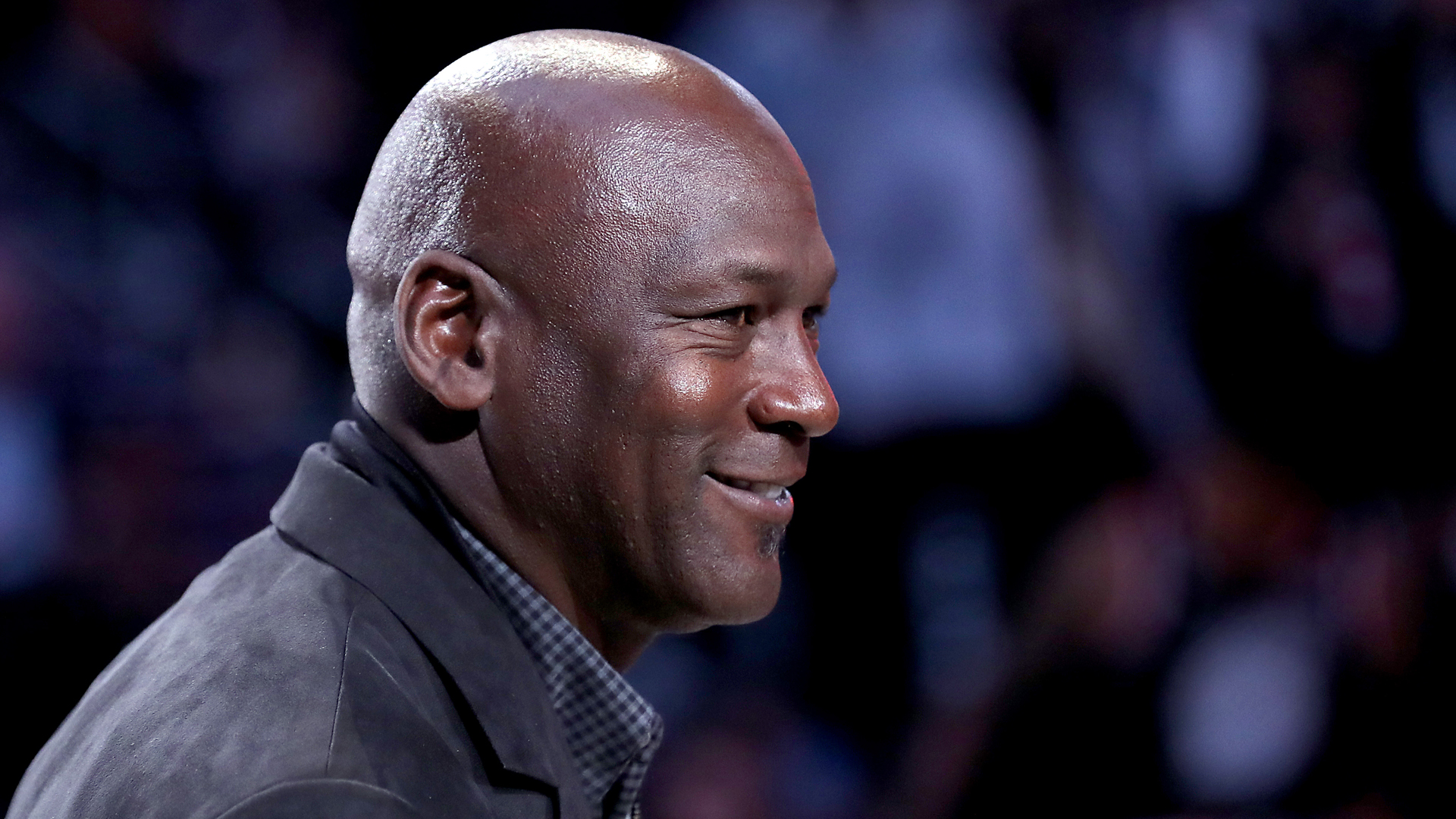 Michael Jordan, owner of the Charlotte Hornets, takes part in a ceremony honoring the 2020 NBA All-Star game during a break in play as Team LeBron take on Team Giannis in the fourth quarter during the NBA All-Star game as part of the 2019 NBA All-Star Weekend at Spectrum Center on February 17, 2019 in Charlotte, North Carolina. (Credit: Streeter Lecka/Getty Images)