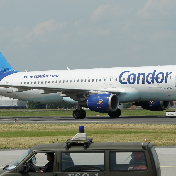 A passenger airplane of German airline Condor, owned by travel agency Thomas Cook, taxis at Schoenefeld Airport during the ILA Berlin Air Show on June 9, 2010 in Berlin, Germany. (Credit: Sean Gallup/Getty Images)