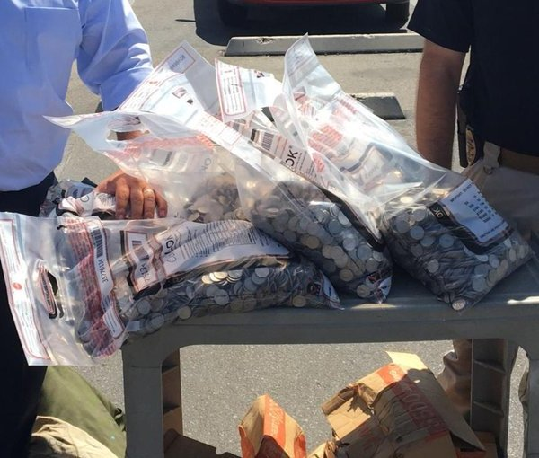 Authorities haul more than $6,000 in quarters in Bakersfield on Sept. 20, 2019. (Credit: Bakersfield police)
