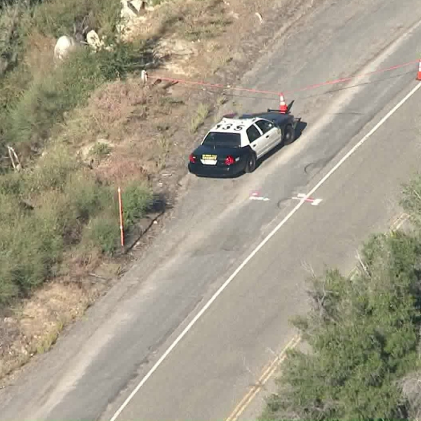 A patrol vehicle sits near the site where human remains were found in the Angeles National Forest on Sept. 11, 2019.