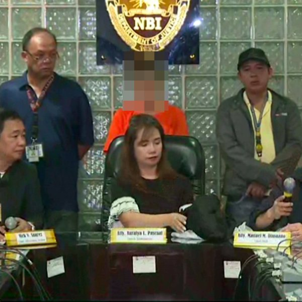 Press conference by the Philippines National Bureau of Investigation on Thursday. The 43-year-old American woman stands in the background. (Credit: CNN Philippines)