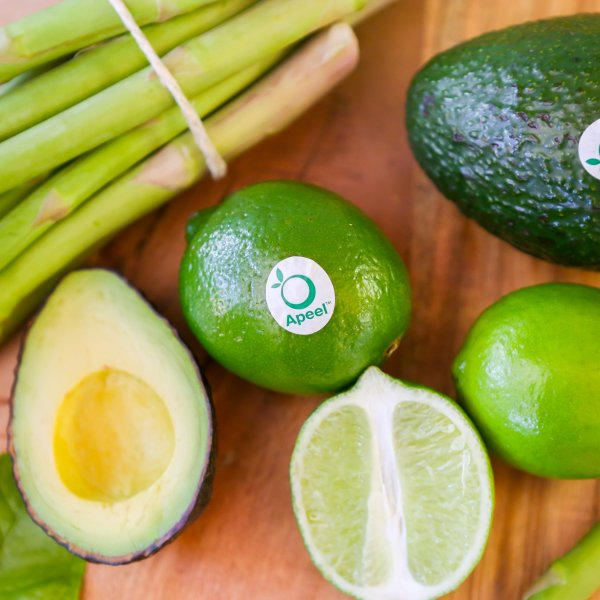 Apeel avocados, limes and asparagus appear in a photo CNN obtained from the company in September 2019.