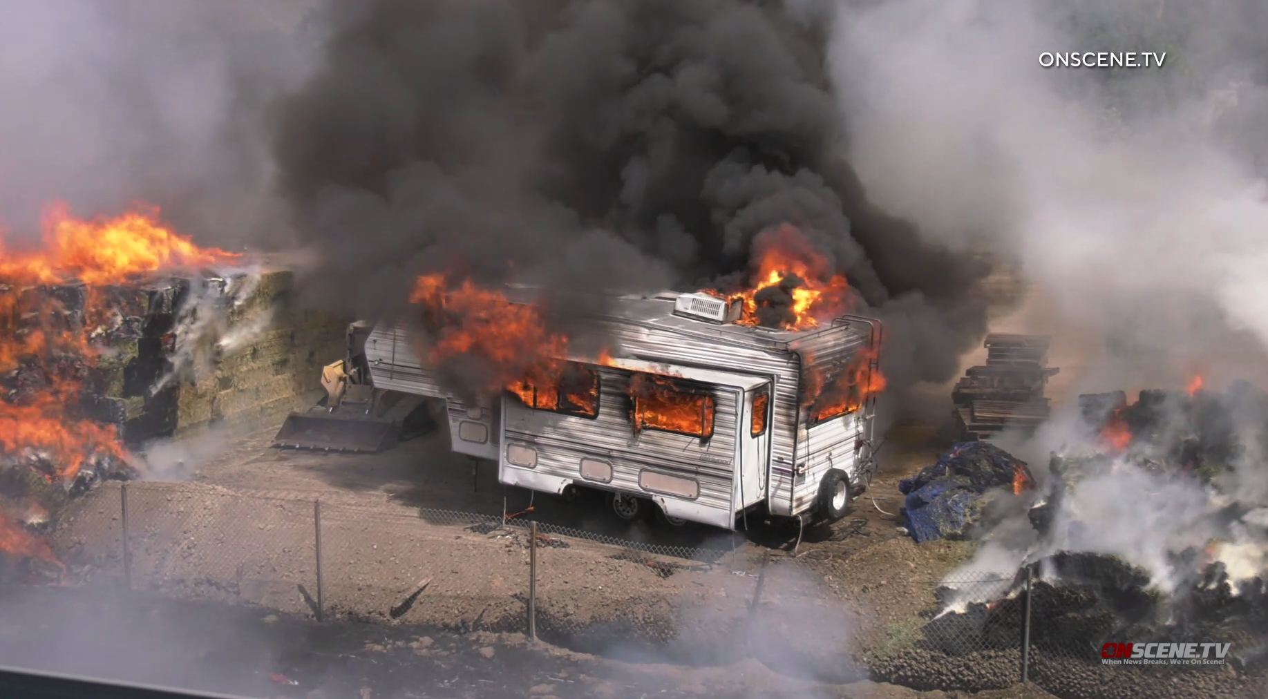 An RV burns in a fire along the 210 Freeway in Pacoima on Sep. 14, 2019. (Credit: Onscene.TV)