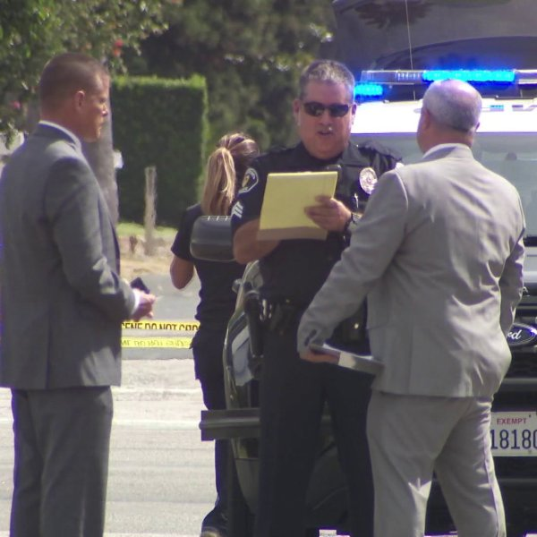 Police investigate the scene of a shooting in the area of Duarte Road and San Gabriel Boulevard in San Marino on Sept. 22, 2019. (Credit: KTLA)