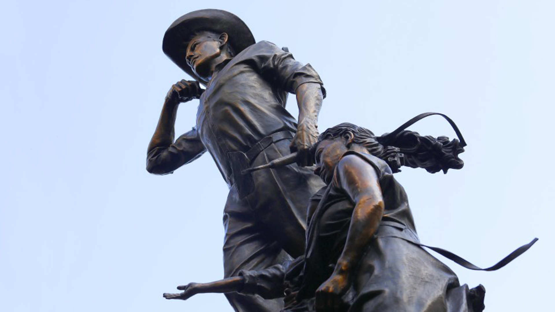 The Bracero Monument, a sculpture by Dan Medina that stands in Migrant's Bend Plaza in downtown Los Angeles, pays tribute to the Mexican workers who temporarily migrated to the U.S. during and after World War II to help fill labor shortages. (Credit: Carolyn Cole / Los Angeles Times)
