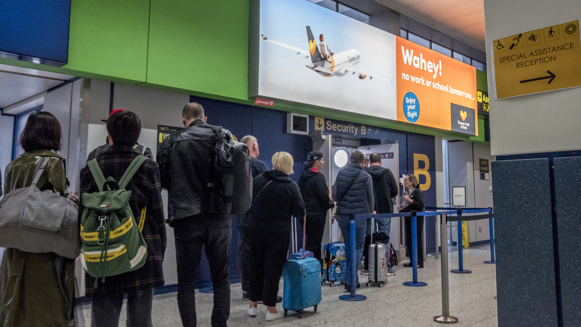 Passengers wait to go through to the Thomas Cook check-in desks at Manchester Airport on September 22, 2019 in Manchester, England. (Credit: Anthony Devlin/Getty Images)