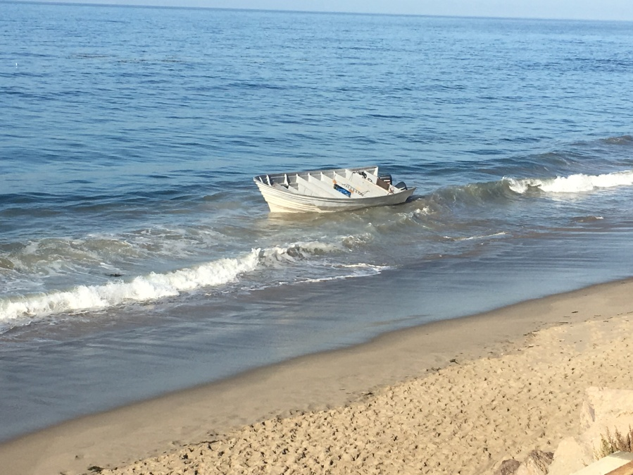 A panga boat that washed ashore carrying bales of marijuana is seen in a photo released by the Ventura County Sheriff's Office on Sep. 15, 2019.