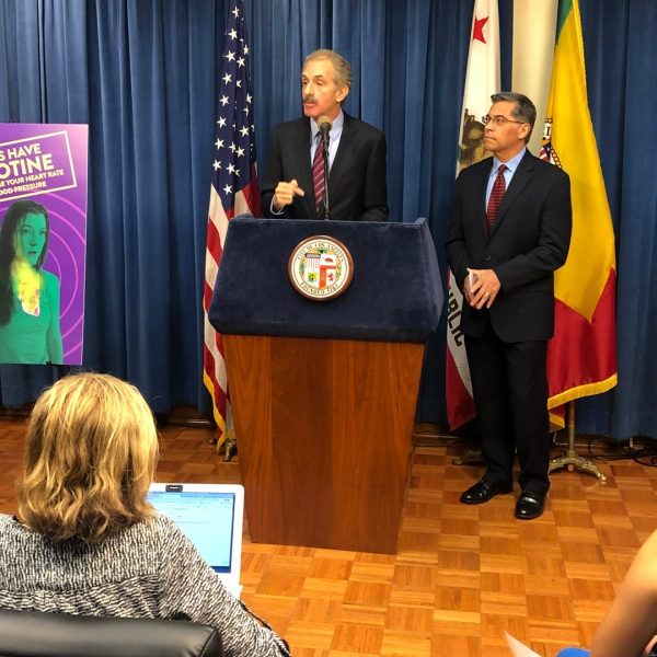 Los Angeles City Attorney Mike Feuer (left) and California Attorney General Xavier Becerra (right) announce an anti-vaping initiative on Sept. 26, 2019. (Credit: KTLA)