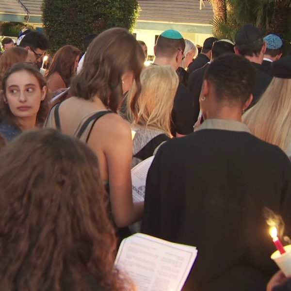 Mourners gather in Northridge on Sept. 12, 2019, for a vigil for student Michael Lertzman, 19, who was shot to death in a double-murder suicide at his family's home in Northridge on Sept. 11, 2019. (Credit: KTLA)