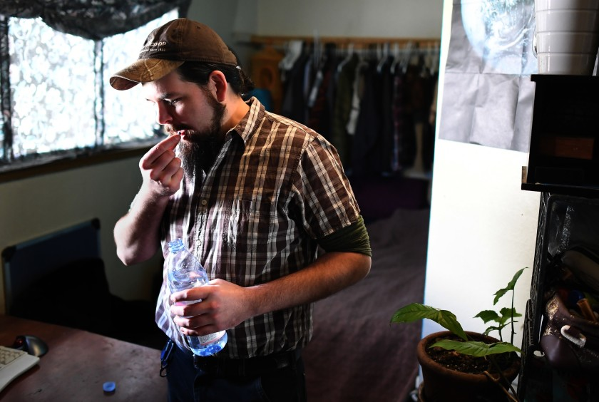 Rand Hunt, 34, takes PrEP in his bedroom in Oakland sometime in the fall of 2019. He was born the year HIV was identified and has lived his entire life in the shadow of the AIDS epidemic. (Credit: Wally Skalij / Los Angeles Times)