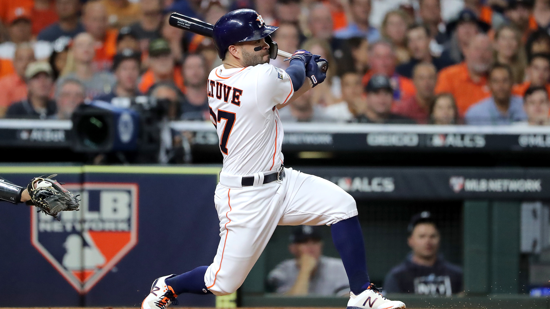 Jose Altuve #27 of the Houston Astros hits a double against the New York Yankees during the first inning in game six of the American League Championship Series at Minute Maid Park on October 19, 2019 in Houston, Texas. (Credit: Elsa/Getty Images)