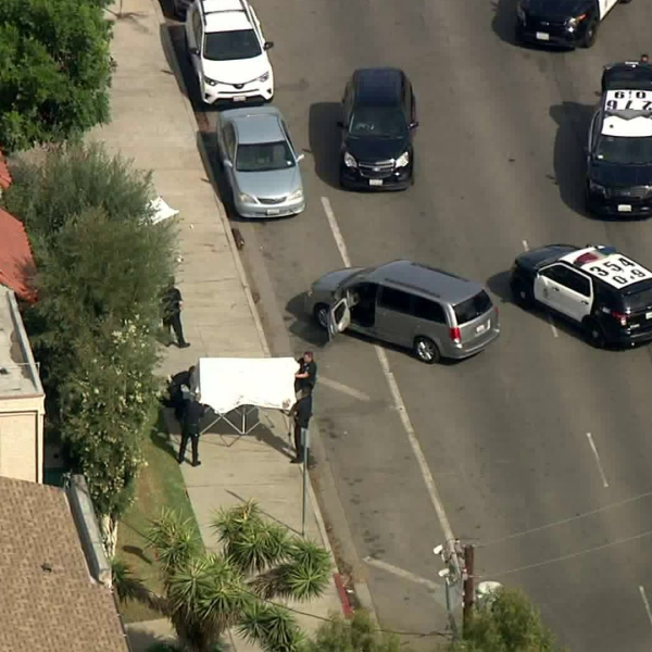 Authorities investigate the scene of a deadly police shooting in Van Nuys on Oct. 16, 2019. (Credit: KTLA)