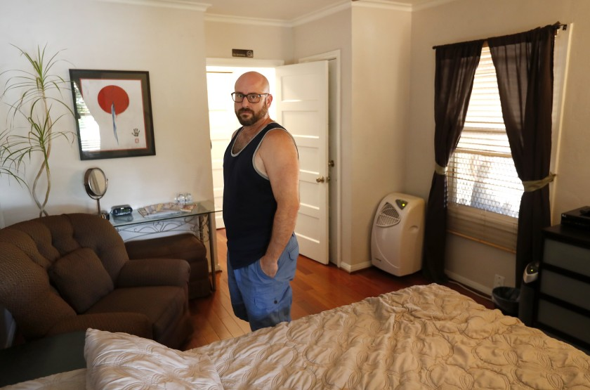 Marc Bochner, who lives in Westlake as a landlord, argues it would be unfair to ban him from hosting short-term rentals in his apartment, which falls under the Rent Stabilization Ordinance. (Credit: Mel Melcon / Los Angeles Times)