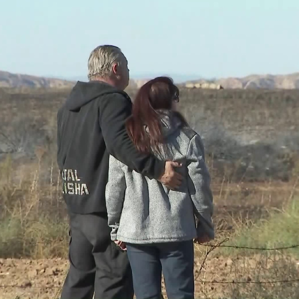 A man and a woman are seen in Calimesa on Oct. 11, 2019 after the Sandalwood Fire broke out the day before. (Credit: KTLA)