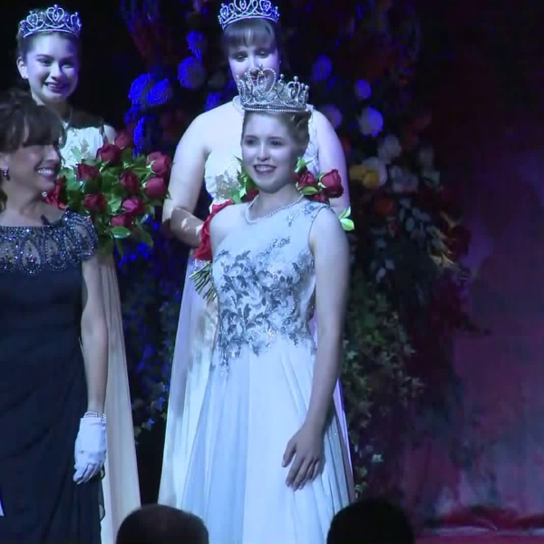 Camille Kennedy, center, is crowned as the 102nd Rose Queen during a ceremony in Pasadena on Oct. 22, 2019. (Credit: KTLA)