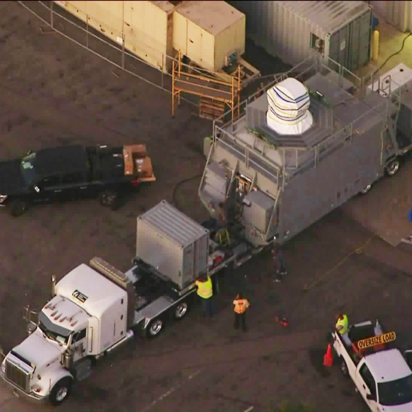 Officials move an undisclosed cargo from a Northrop Grumman Facility in Redondo Beach en route to a barge to be transported to San Diego as part of a U.S. Navy project on Oct. 18, 2019. (Credit: KTLA)