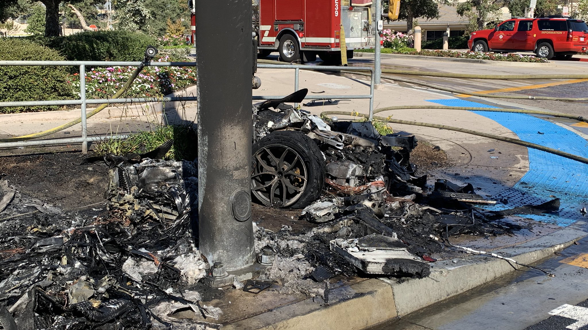The Orange County Fire Authority released this photo showing the remains of a car that crashed into a pole and erupted in flames on Oct. 23, 2019.