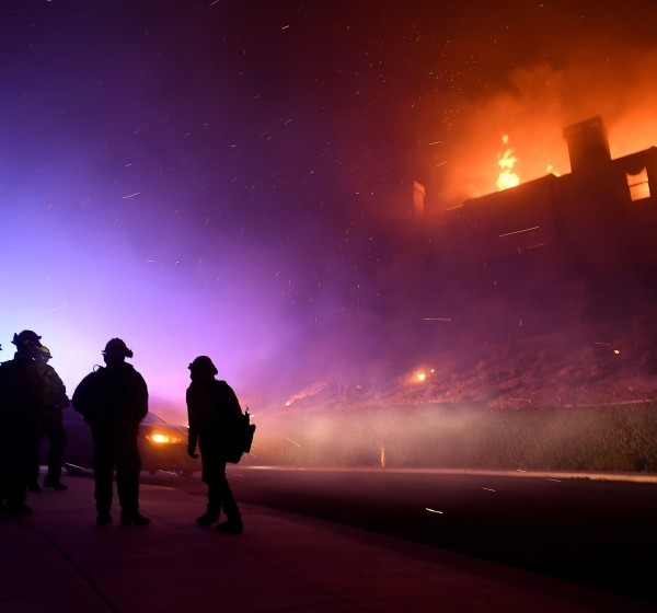 Firefighters monitor a house fully engulfed on Mountain Crest Circle in Thousand Oaks during the 2018 Woolsey Fire.(Credit: Wally Skalij/Los Angeles Times)