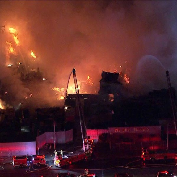 Crews respond to a fire ripping through a pallet yard in the Florence-Firestone area of South Los Angeleson Oct. 30, 2019. (Credit: KTLA)