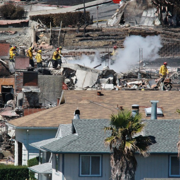 Firefighters sift through rubble at a burned home that was destroyed by a massive explosion and fire on Sep. 10, 2010, in San Bruno, California.(Credit: Justin Sullivan/Getty Images)
