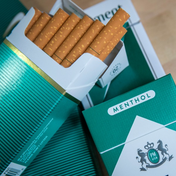 In this photo illustration, packs of menthol cigarettes sit on a table in New York City on Nov. 15, 2018. (Credit: Drew Angerer / Getty Images)