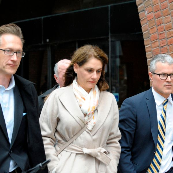 Michelle Janavs makes her way out of the courthouse after giving her plea in front of a judge for charges in the college admissions scandal at the John Joseph Moakley U.S. Courthouse on March 29, 2019. (Credit: JOSEPH PREZIOSO/AFP/Getty Images)