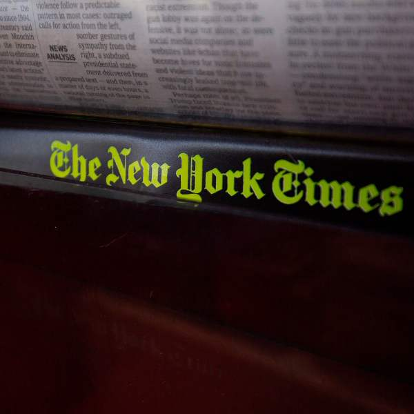 The New York Times logo is seen on a newspaper rack at a convenience store in Washington, D.C., on Aug. 6, 2019. (Credit: ALASTAIR PIKE/AFP/Getty Images)
