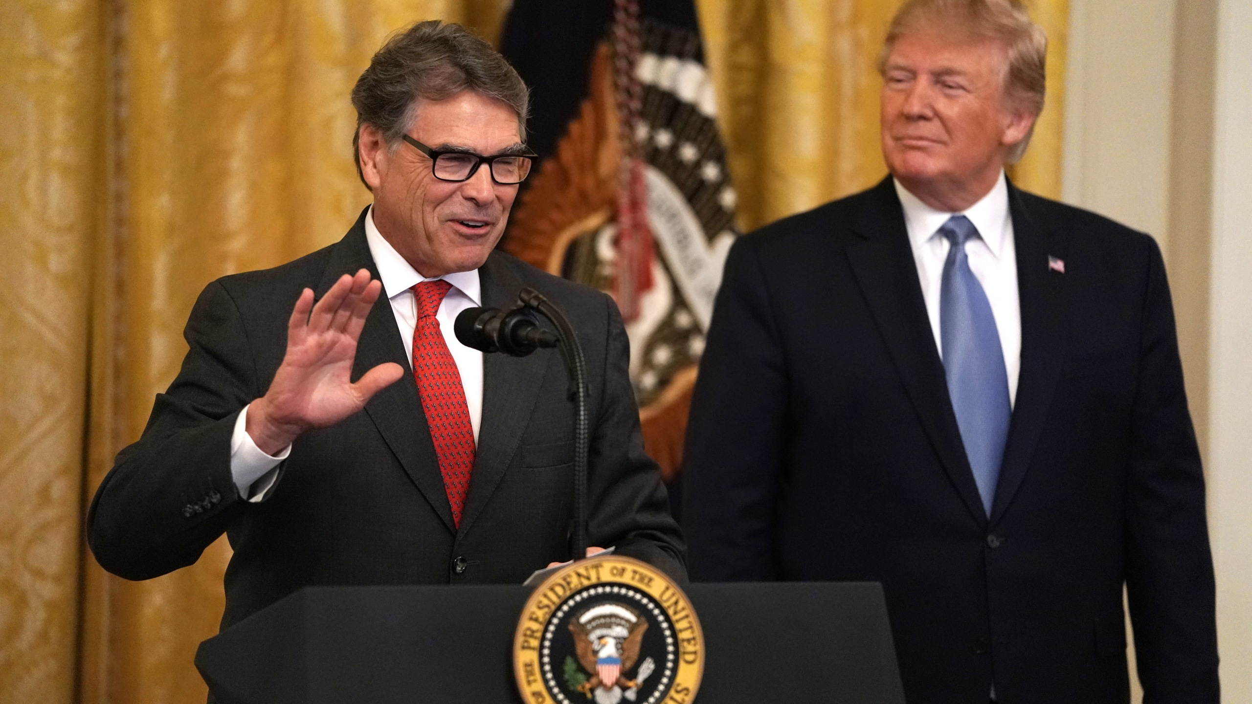 U.S. Secretary of Energy Rick Perry speaks as President Donald Trump looks on during an East Room event on the environment, July 7, 2019, at the White House in Washington, D.C. (Credit: Alex Wong/Getty Images)