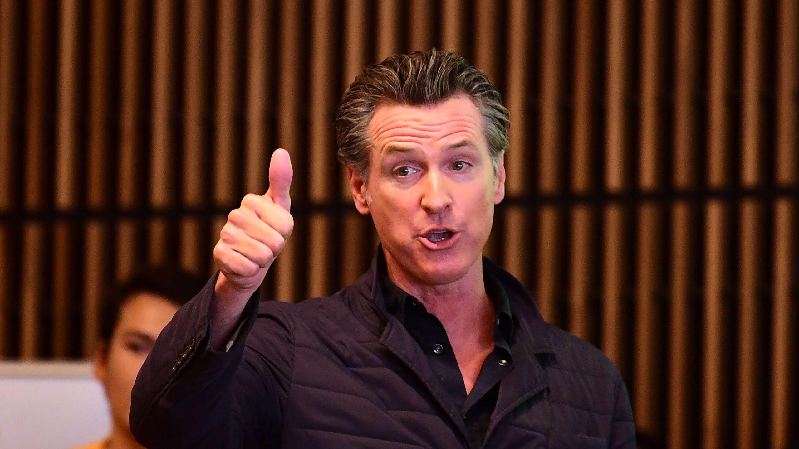 California Governor Gavin Newsom gives a thumbs up during a visit to East Los Angeles College in Monterey Park on Aug. 29, 2019. (Credit: FREDERIC J. BROWN/AFP/Getty Images)