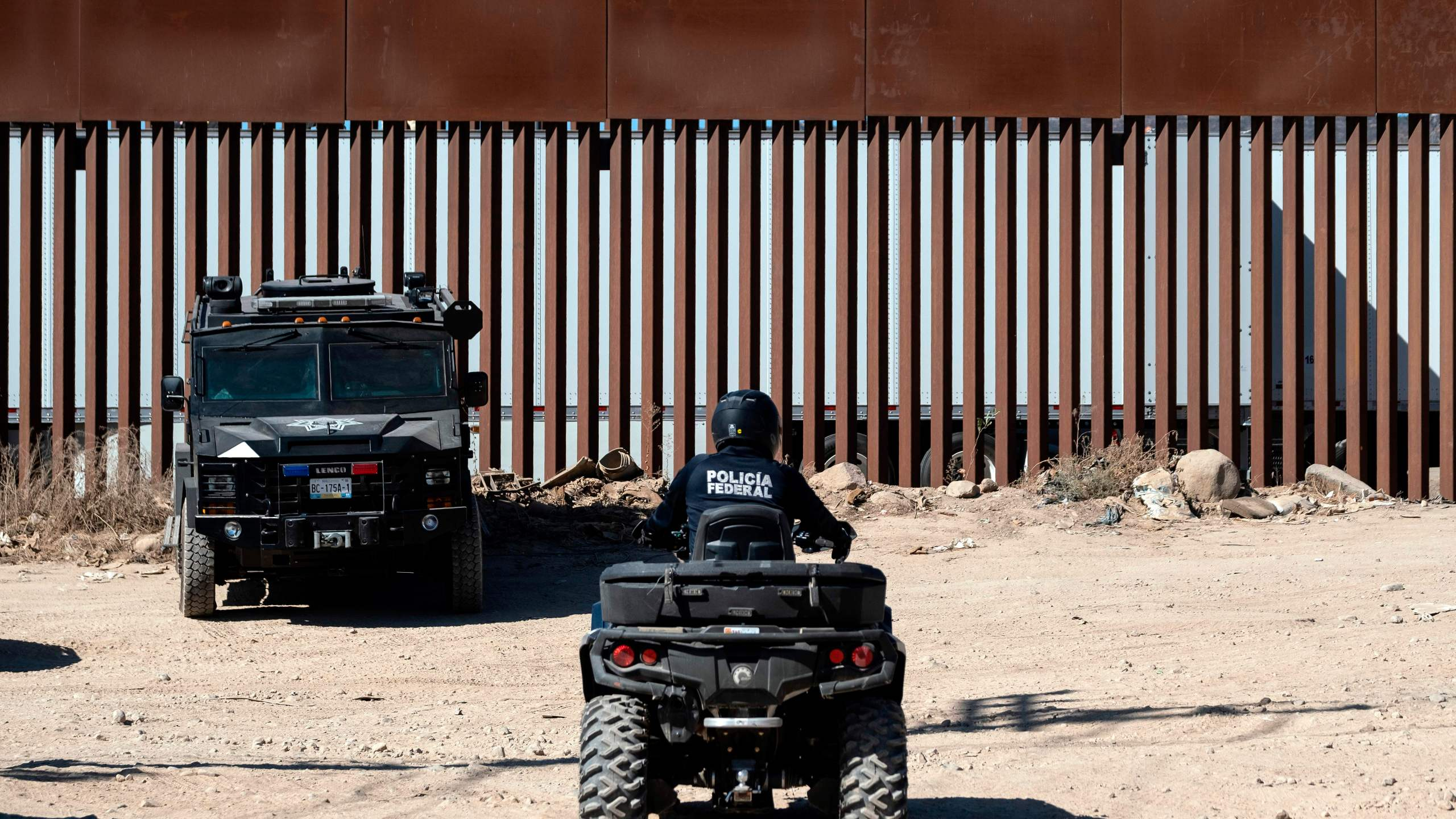 Mexican security forces patrol near the U.S.-Mexico border fence in Tijuana, Mexico, on Sept. 18, 2019. (Credit: Guillermo Arias/AFP/Getty Images)