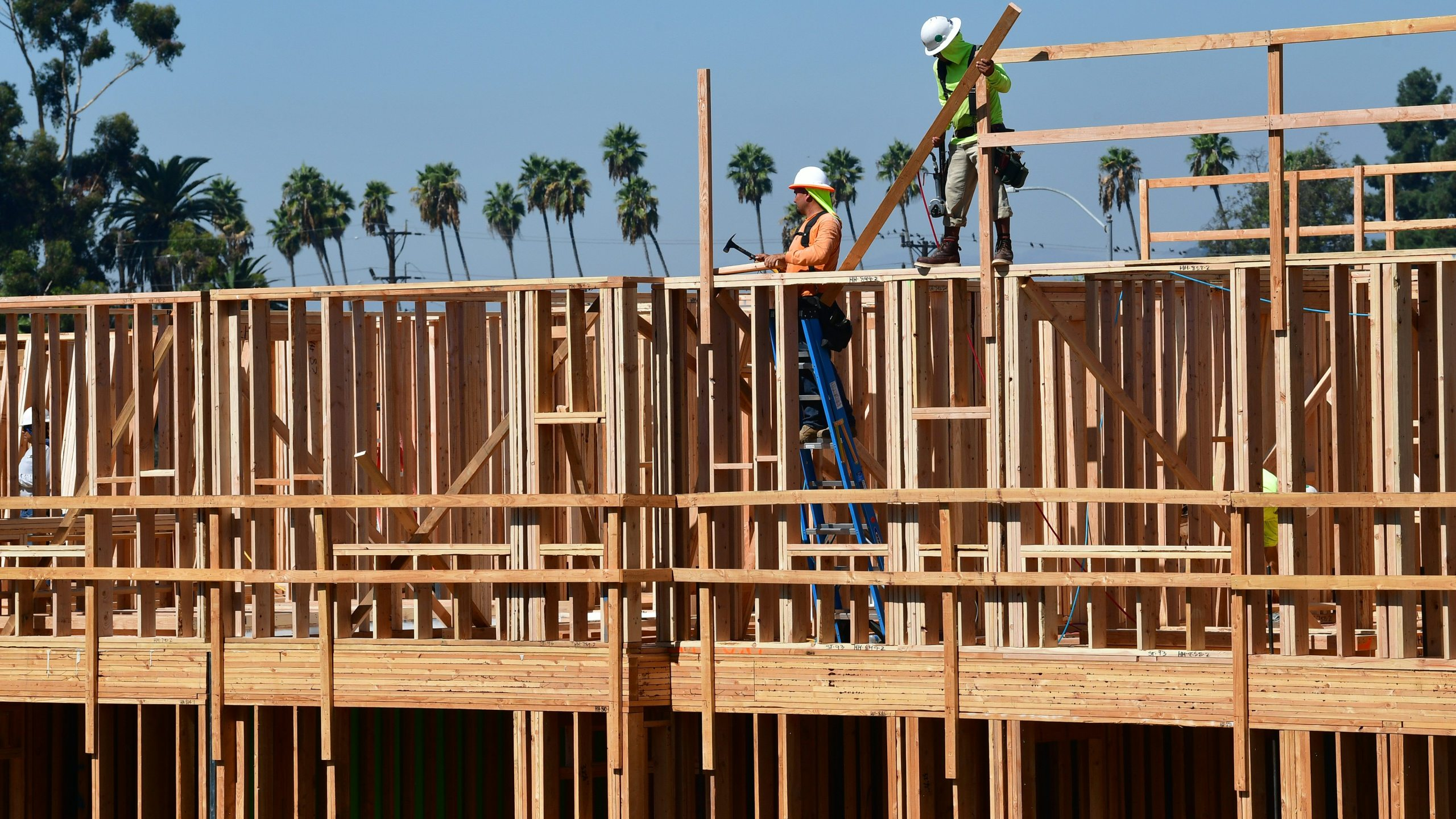 Construction workers are seen on the site of a new building in Los Angeles, California on Oct. 8, 2019. (Credit: Frederic J. Brown /AFP via Getty Images)