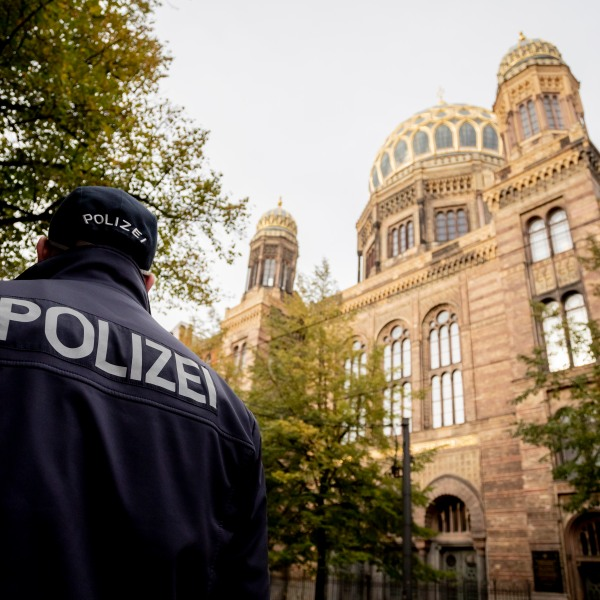 A policeman stands guard in front of the Neue Synagoge (New Synagogue) in Berlin, Germany, as increased security measures are taken following a shooting in Dresden, eastern Germany, on October 9, 2019. (Credit: CHRISTOPH SOEDER/dpa/AFP via Getty Images)