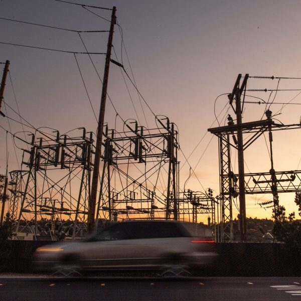 A car drives passed a power station in Mill Valley during a Pacific Gas & Electric blackout on Oct. 10, 2019. (Josh Edelson / AFP / Getty Images)
