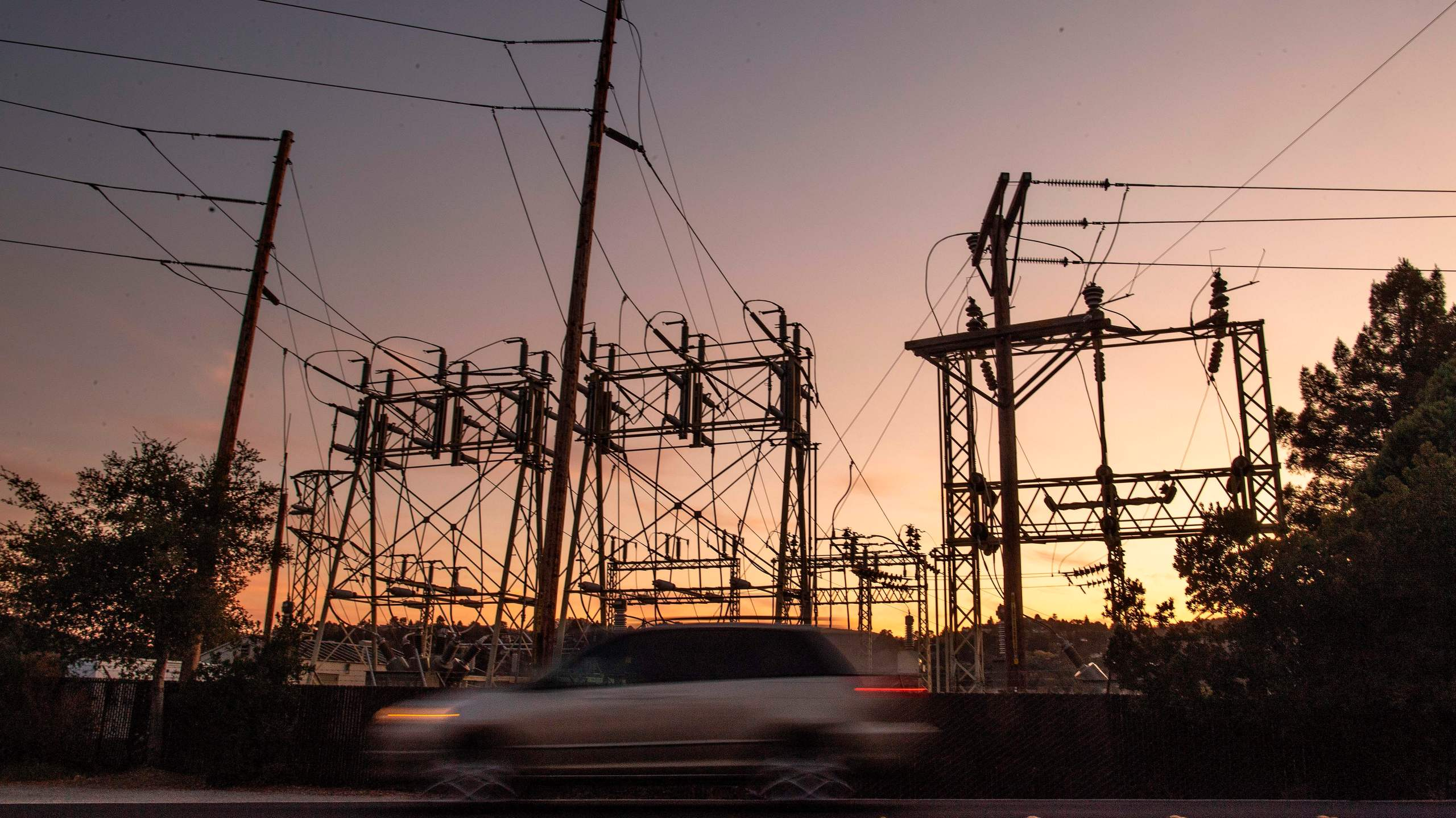 A car drives passed a power station in Mill Valley, Calif., as a blackout continues on Oct., 10, 2019. More than a million Californians were without electricity due to pre-emptive blackouts to prevent wildfires. (JOSH EDELSON/AFP via Getty Images)