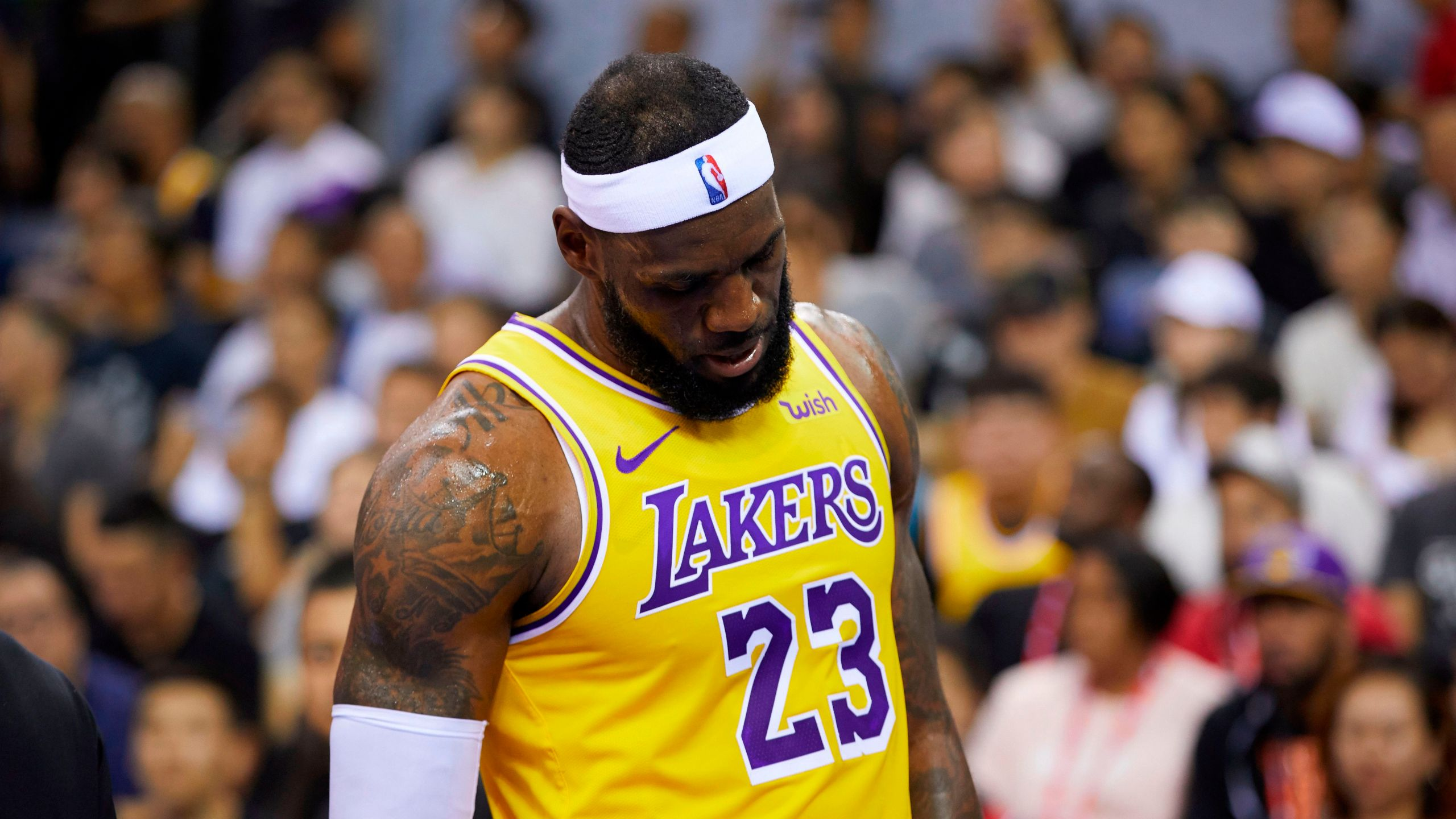 Lakers star LeBron James reacts during the NBA pre-season game between Los Angeles and Brooklyn Nets in Shenzhen, in China's southern Guangdong province on October 12, 2019. (Credit: STR/AFP via Getty Images)
