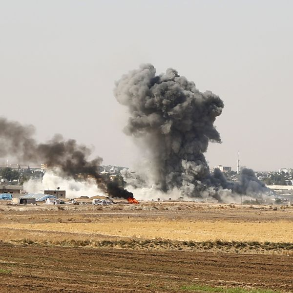 Smoke billows from the Syrian border town of Ras al-Ayn on Oct. 12, 2019, as Turkey and its allies continued their assault on Kurdish-held border towns in northeastern Syria. (Credit: Nazeer Al-khatib/ AFP via Getty Images)