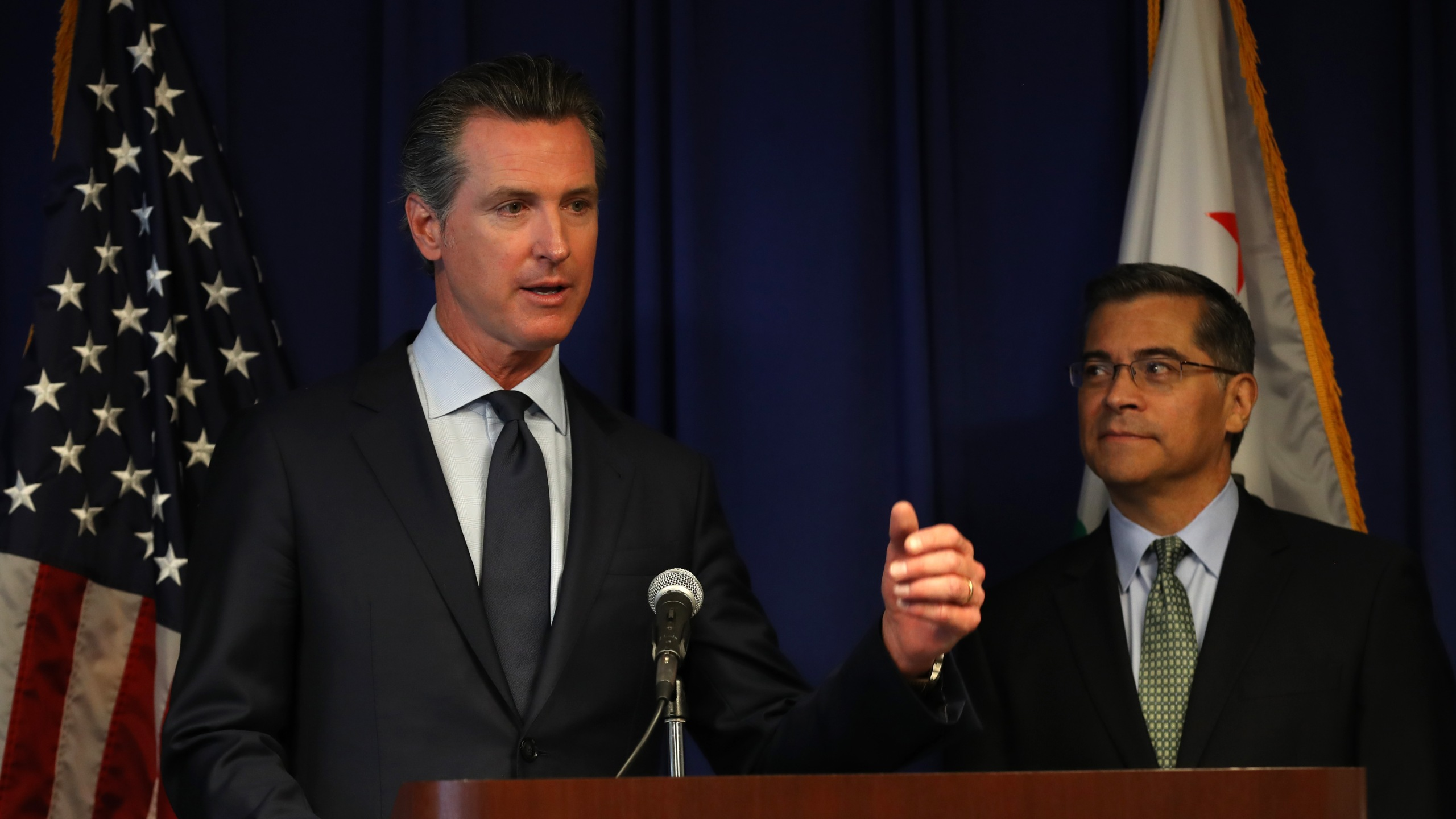 California attorney general Xavier Becerra looks on as California Gov. Gavin Newson speaks during a news conference at the California justice department on Sept. 18, 2019, in Sacramento. (Credit: Justin Sullivan/Getty Images)