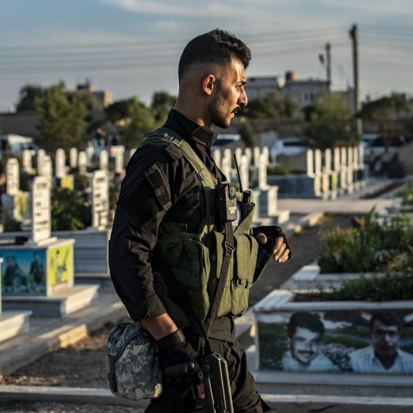 A combatant attends the funeral of five Syrian Democratic Forces' fighters killed in battles against Turkey-led forces in the flashpoint town of Ras al-Ain along the border, on Oct. 14, 2019, in the Syrian Kurdish town of Qamishli. (Credit: DELIL SOULEIMAN/AFP via Getty Images)